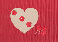 Cardboard heart with paper flowers on red background Stock Photography