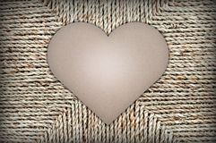 Cardboard heart shape on background of wicker basket. space for text stock photography