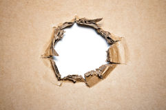 Cardboard hole Stock Images