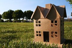Cardboard House. A two story cardboard house on a green expense of lawn Royalty Free Stock Photos