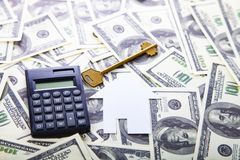 Cardboard house,calculator and key. On the money. Buying a property Royalty Free Stock Photo