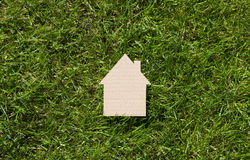Cardboard house on green grass Stock Images