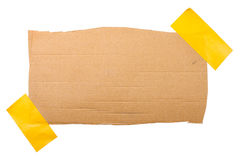 Cardboard labe attached with a sticky tape Royalty Free Stock Image