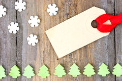 Cardboard label tag with snow flakes and christmas tree sweets Royalty Free Stock Photography
