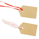 Cardboard labels on red and white ribbons Stock Photo