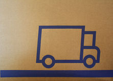 Cardboard Moving Box. A carton box with a truck icon on it stock image