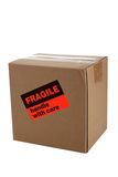 Cardboard moving box with a fragile sticker royalty free stock images