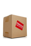 A cardboard moving box with a fragile sticker Stock Images
