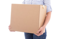 Cardboard moving box in woman hands isolated on white Royalty Free Stock Photo
