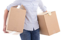 Cardboard moving boxes in woman hands isolated on white. Background Royalty Free Stock Images