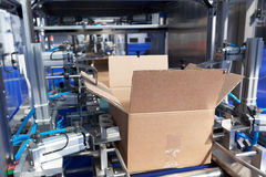 Cardboard package box packing machine. Automatic cardboard box erector machine Stock Photography