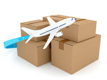 Cardboard packages with airplane over white Stock Images