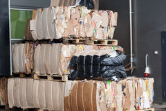 Cardboard packaging waste paper market pressed stack Stock Images