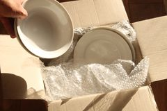 Cardboard Packing Box, Plates and Bubble Wrap royalty free stock photo