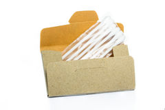 Cardboard paper box with cotton buds. Isolated on white background Royalty Free Stock Photography