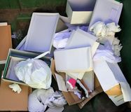 Cardboard and paper garbage trash container Royalty Free Stock Images