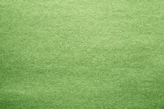 Cardboard and paper of green color. Texture of a surface of a leaf of a cardboard and paper for a background and for wallpaper of green color Royalty Free Stock Photography