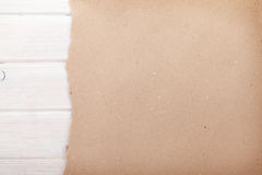 Cardboard paper over white wood background Stock Image