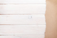 Cardboard paper over white wood background Stock Photos