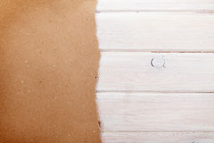 Cardboard paper over white wood background Royalty Free Stock Image