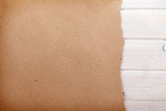 Cardboard paper over white wood background Stock Photo