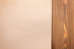 Cardboard paper over wooden background Stock Images