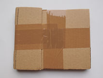 Cardboard parcel with adhesive tape Royalty Free Stock Images