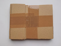 Cardboard parcel with adhesive tape Royalty Free Stock Photos