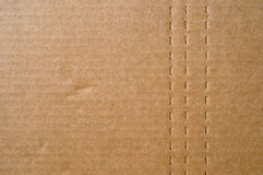 Cardboard with Perforated Lines Royalty Free Stock Images