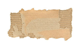 Cardboard piece. Ripped cardboard piece isolated on white royalty free stock image