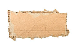 Cardboard piece. Ripped cardboard piece isolated on white stock photography