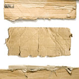 Cardboard pieces. On the isolated white background Stock Images