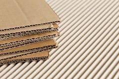 Cardboard pile on corrugated background Stock Photo