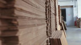 Cardboard in piles in stock. Close up stock footage