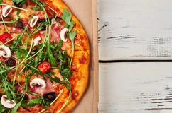 Cardboard with pizza. Stock Image