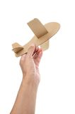 Cardboard plane. On wooden desk with filtered Royalty Free Stock Photos