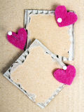 Cardboard plaques and felt hearts. Cardboard plaques and pink felt hearts - Valentine background stock photo