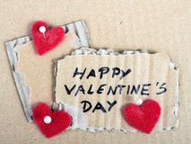 Cardboard plaques and felt hearts. Cardboard plaques and red felt hearts - Valentine background stock image