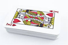 Cardboard playing cards for card games - King Hearts. In studio environment stock images