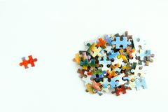 Cardboard puzzles with a pattern on a white background. Close-up. stock photography