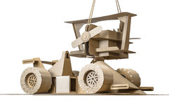Cardboard racing car and cardboard plane Royalty Free Stock Images