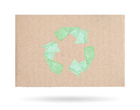 Cardboard with a recycle symbol, isolated on a white background. Stock Photos
