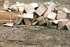 Cardboard Recycles. Empty cardboard boxes ready for recycling at a construction site Stock Photo