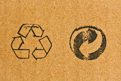 Cardboard with recycling symbol Royalty Free Stock Photography