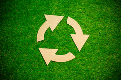 Cardboard recycling symbol on the grass Royalty Free Stock Photography