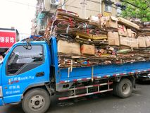 Cardboard Recycling Truck. A truck is piled high with cardboard to be recycled royalty free stock photo