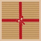 Cardboard with red ribbon Stock Photography