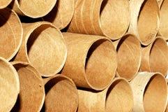 Cardboard rolls. A background full of brown cardboard rolls royalty free stock image
