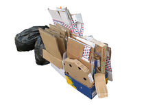 Cardboard rubbish and plastic. A pile of rubbish waiting to be taken away either for dumping or recycling Stock Photos