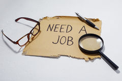 Cardboard that says need a job Royalty Free Stock Photography
